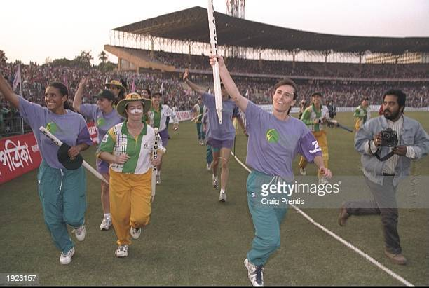 Belinda Clark of Australia leads the lap of honour after victory over New Zealand in the Women's Cricket World Cup Final at Eden Gardens in Calcutta,...