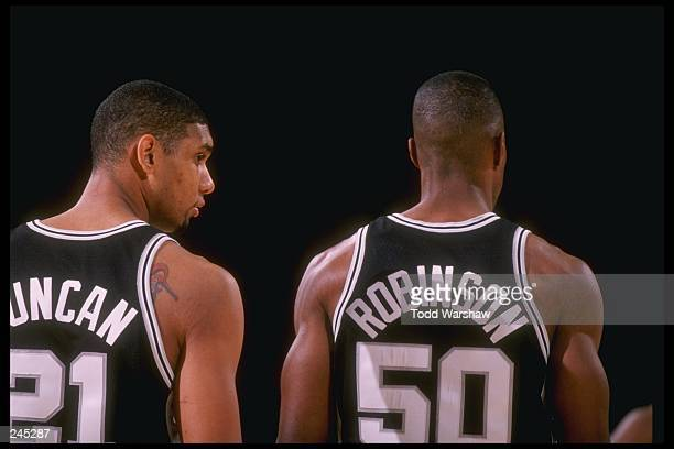 Centers Tim Duncan and David Robinson of the San Antonio Spurs stand together during a game against the Los Angeles Lakers at the Great Western Forum...