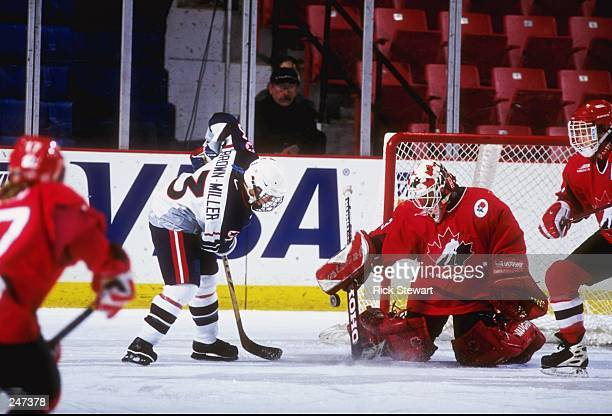 Goaltender Manon Rheaume of Canada defends against Lisa BrownMiller of the United States during the 3 Nations Cup Championship game on 1980 Rink L in...