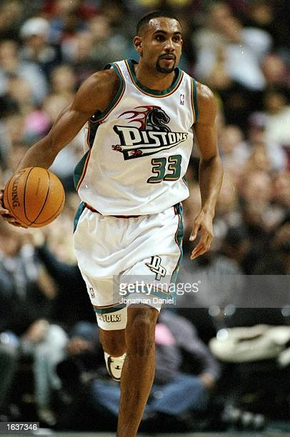 Grant Hill of the Detroit Pistons runs towards the basket in a match between the Detroit Pistons v Miami Heat in the NBA League played at the Palace...