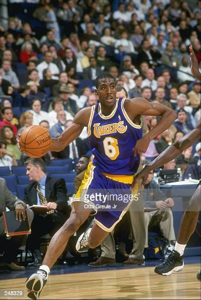 Guard Eddie Jones of the Los Angeles Lakers dribbles the ball down the court during a game against the Golden State Warriors at the Oakland Coliseum...