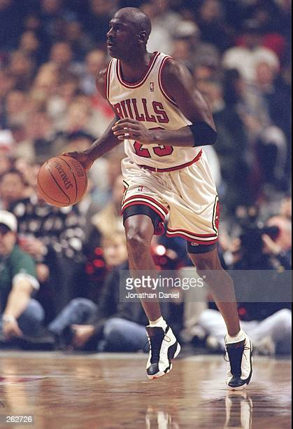 Guard Michael Jordan of the Chicago Bulls moves the ball during a game against the New York Knicks at the United Center in Chicago Illinois The Bulls...