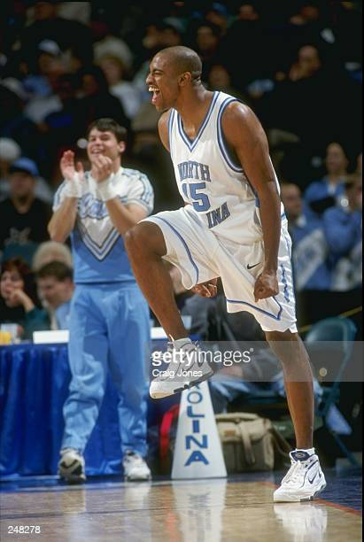 Guard Vince Carter of the North Carolina Tar Heels celebrates during a game against the Tennessee at Chattanooga Moccasins during the Harus Teeter...