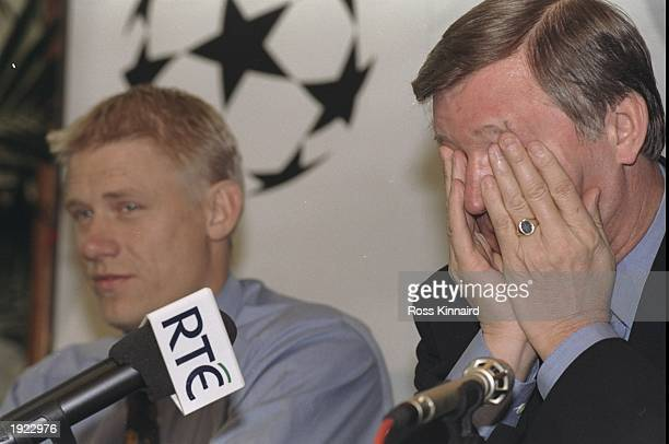 Manchester United manager Alex Ferguson and his captain Peter Schmeichel attend a press conference before the UEFA Champions League match against...