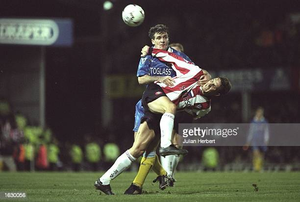 Mark Hughes of Chelsea and Claus Lundekvam of Southampton battle for the ball during the FA Carling Premiership match at The Dell in Southampton...