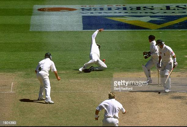Mark Taylor of Australia fielding as first slip catches Adam Bacher of South Africa off the bowling of Shane Warne during the first test match at the...
