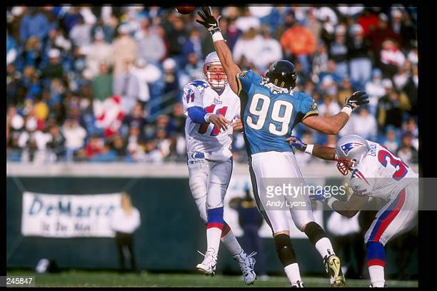 Quarterback Drew Bledsoe of the New England Patriots passes the ball during a game against the Jacksonville Jaguars at Alltell Stadium in...