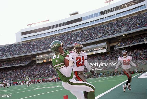 Receiver Jeff Graham of the New York Jets catches a pass on defensive back Donnie Abraham of the Tampa Bay Buccaneers during the Jets 310 win at the...