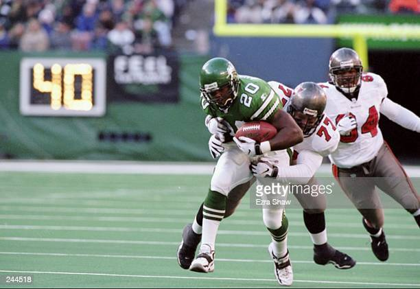 Richie Anderson of the New York Jets is wrapped up by Brad Culpepper of the Tampa Bay Buccaneers during the Jets 310 win at the Meadowlands in East...