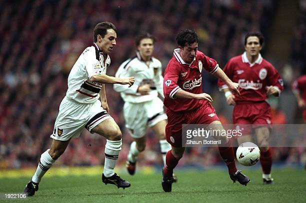 Robbie Fowler of Liverpool takes on Gary Neville of Manchester United during an FA Carling Premiership match at Anfield in Liverpool England...
