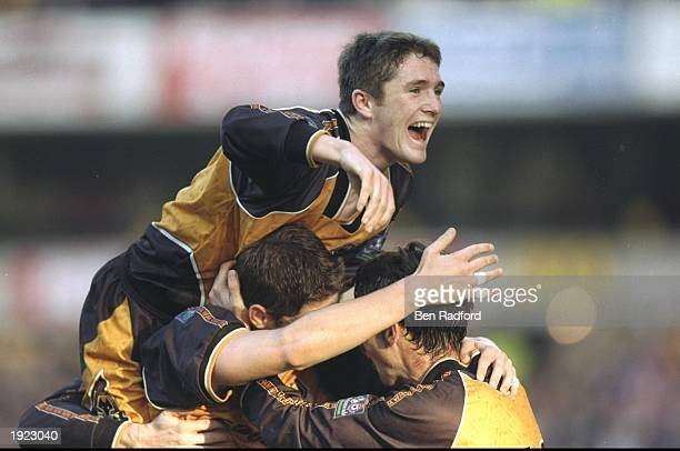 Robbie Keane of Wolverhampton Wanderers celebrates with team mates during the Nationwide Division One match against Nottingham Forest at Molineux in...