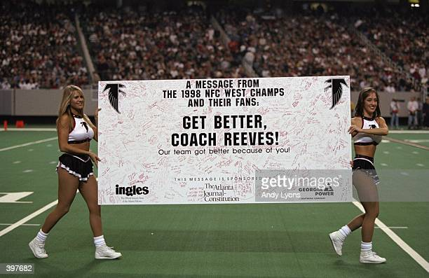 Cheerleaders carry a Get Better sign for coach Dan Reeves of the Atlanta Falcons during the game against the Miami Dolphins at the Georgia Dome in...