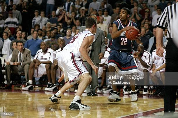 Forward Mike Babul of the UMass Minutemen in action against guard/forward Richard Hamilton of the UConn Huskies during the game at Mullins Center in...