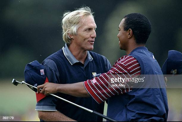 Greg Norman of Australia shakes Tiger Woods of the United States hand after their match action during the 1998 Presidents Cup at the Royal Melbourne...