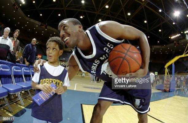 Guard Eddie Jones with a young fan during the Chris Mills Charity Game in Pauley Pavillion in Westwood California
