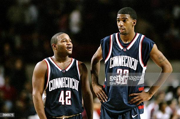 Guard Khalid ElAmin and guard/forward Richard Hamilton of the UConn Huskies confer during the game against the UMass Minutemen at Mullins Center in...
