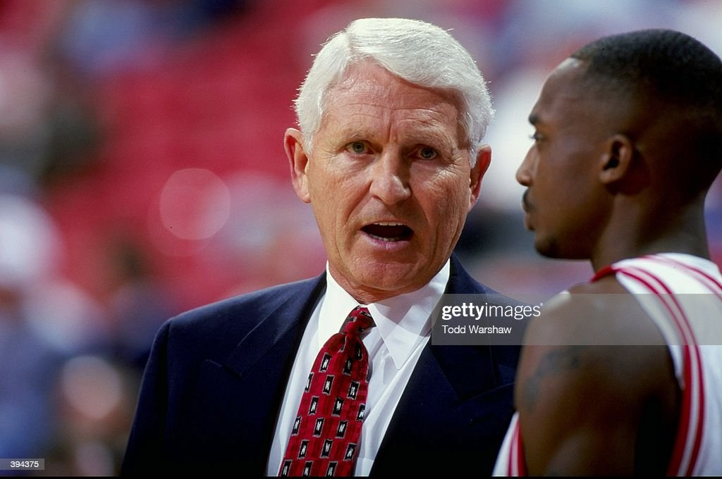 Head Coach Lute Olson of the Arizona Wildcats is talking to Jason Terry #31 next to the bench during the Las Vegas Shoot Out Game against the Iowa State Cyclones at the Thomas & Mack Center in Las Vegas, Nevada. The Wildcats defeated Cyclones 75-61.