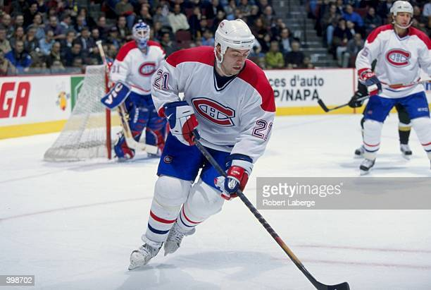 Jason Dawe the Montreal Canadiens controls the puck during the game against the Dallas Stars at the Molson Centre in Montreal Canada The Stars and...
