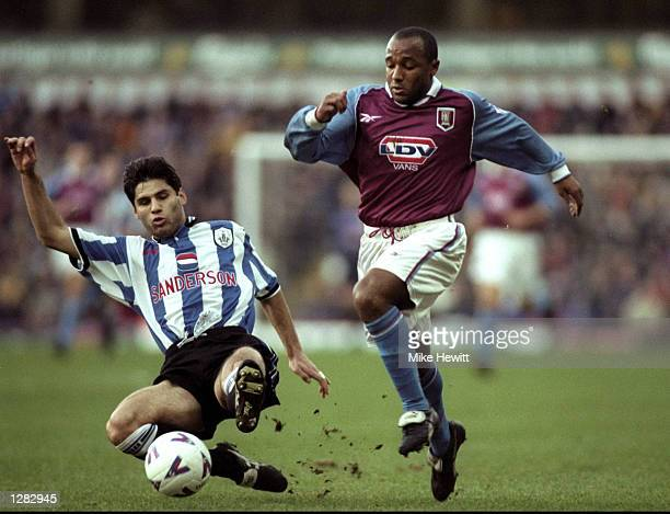 Julian Joachim of Aston Villa is challenged by Dejan Stefanovic of Sheffield Wednesday in the FA Carling Premiership match at Villa Park in...