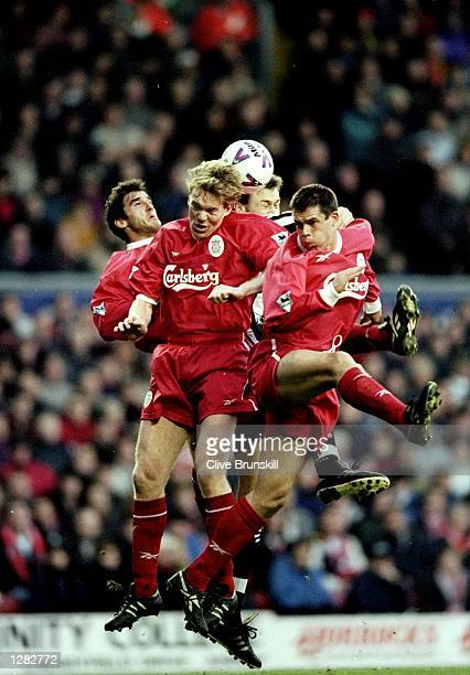Karl Heinz Riedle Steve Staunton and Jamie Carragher of Liverpool rise to deny Duncan Ferguson of Newcastle United in the FA Carling Premiership...