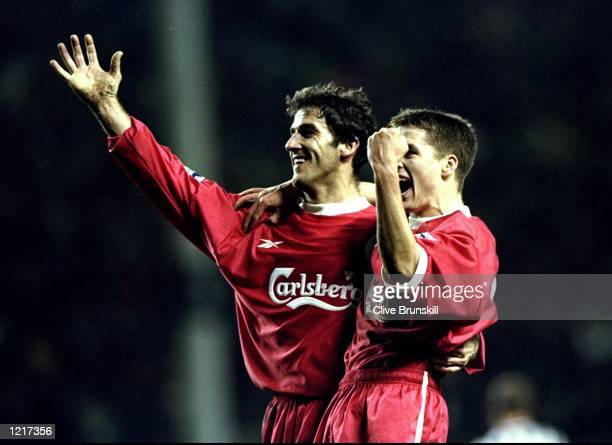 KarlHeinz Reidle and Michael Owen of Liverpool celebrate a goal during the FA Carling Premiership match against Newcastle United played at Anfield in...