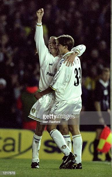 Lee Bowyer and Alan Smith of Leeds United celebrate a goal together during the FA Carling Premiership match against West Ham United played at Elland...