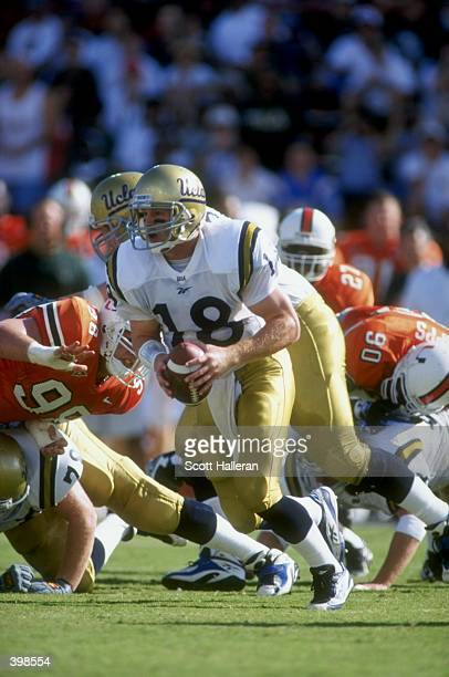 Quarterback Cade McNown of the UCLA Bruins in action during the game against the University of Miami Hurricanes at the Orange Bowl in Miami Florida...