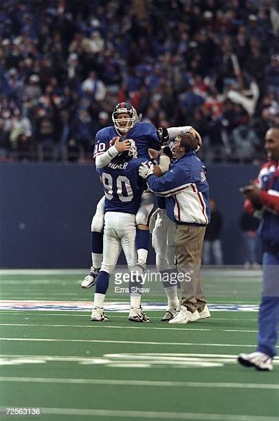 Quarterback Kent Graham of the New York Giants celebrates during the game against the Denver Broncos at Giants Stadium in East Rutherford New Jersey...