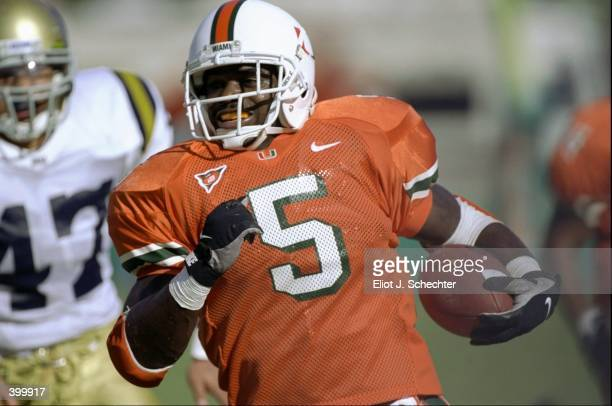 Running back Edgerrin James of the University of Miami Hurricanes in action during the game against the UCLA Bruins at the Orange Bowl in Miami,...