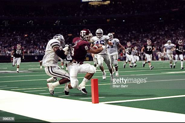 Running back Sirr Parker of the Texas AM Aggies in action against defensive back Lamar Chapman of the Kansas State Wildcats during the Big 12...