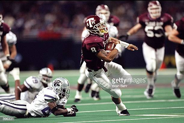 Running back Sirr Parker of the Texas AM Aggies in action against defensive back Jerametrius Butler of the Kansas State Wildcats during the Big 12...