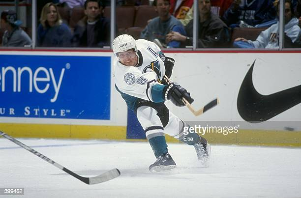 Teemu Selanne of the Anaheim Mighty Ducks shoots during the game against the Vancover Canucks at the Arrowhead Pond in Anaheim California The Ducks...
