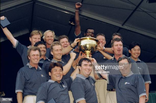 The International Team celebrate their win as they hold up the Presidents Cup Trophy after the 1998 Presidents Cup at the Royal Melbourne Golf Course...