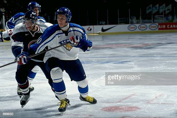 Tommi Santala of Team Finland in action during the World Junior Hockey Championships Game against Team USA at the Winnepeg Arena in Winnepeg,...