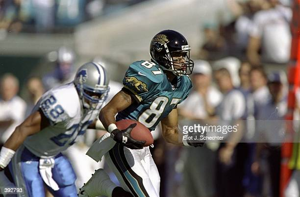 Wide receiver Keenan McCardell of the Jacksonville Jaguars in action against safety Ron Rice of the Detroit Lions during a game at Alltel Stadium in...