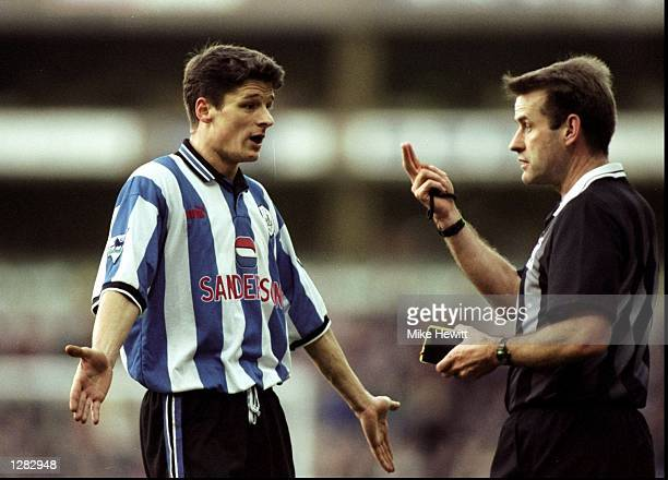 Wim Jonk of Sheffield Wednesday appeals to referee Graham Barber on behalf of team mate Dejan Stefanovic who was sent off against Aston Villa in the...