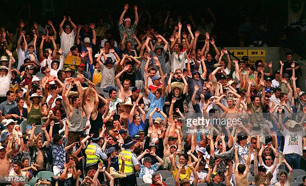 A section of the crowd participate in a Mexican Wave during the Boxing Day Cricket Test match between Australia and India at the Melbourne Cricket...