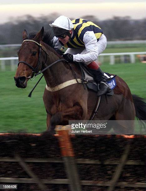 Anzum and Richard Johnson approach the last flight at Ascot before going on to win The Cantor Fitzgerald Long Walk Hurdle Race Mandatory Credit...
