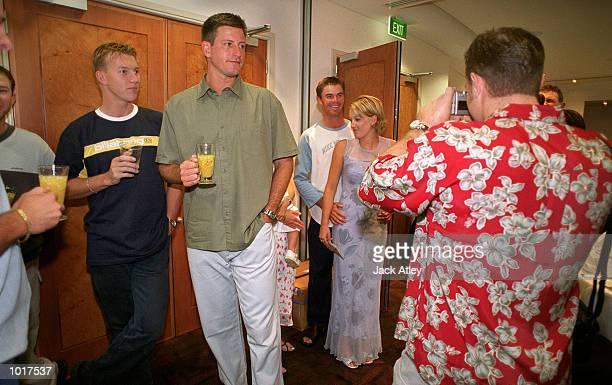 Australian cricket team members Brett Lee and Michael Kasprowicz watch Michael Slater take a picture of Greg Blewett and friend during the Australian...
