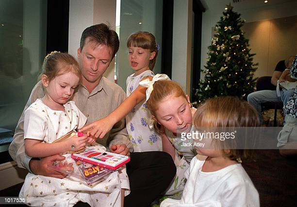 Australian cricketer captain Stephen Waugh watches daughter Rosealie play with other team members children during the Australian team's Christmas...
