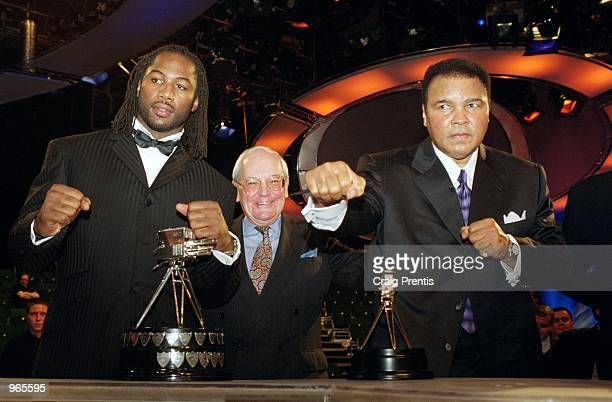 Boxing legends past and present Lennox Lewis Harry Carpenter and Muhammad Ali pose for the cameras at the BBC Sports Personality of the Year Awards...