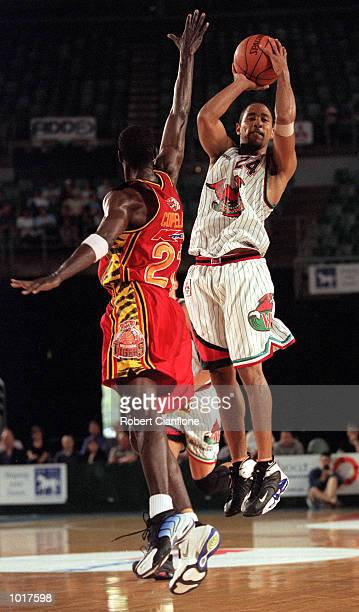 CJ Bruton of the Wollongong Hawks about to get the ball past Lanard Copeland of the Melbourne Tigers during todays National Basketball League match...