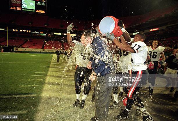 Coach Ron Turner of the Illinois Fighting Illini has the Gatorade poured over him after the Micron PC Bowl Game against the Virginia Cavaliers at the...