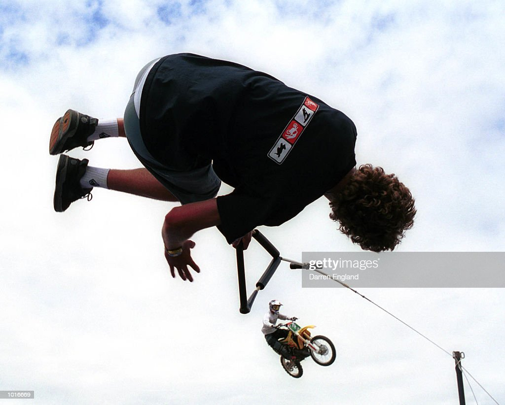 Daniel Watkins of Brisbane and Motorcross rider Troy Carroll flies high during practice at the Extreme Games in Brisbane,Australia. Mandatory Credit: Darren England/ALLSPORT