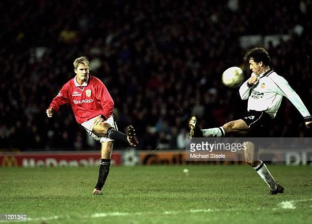 David Beckham of Manchester United shoots during the Champions League game against Valencia at Old Trafford Manchester England Manchester United won...