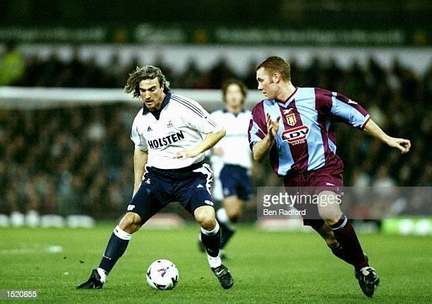 David Ginola of Tottenham Hotspur is watched by Steve Watson of Aston Villa during the FA Carling Premiership match at Villa Park in Birmingham...