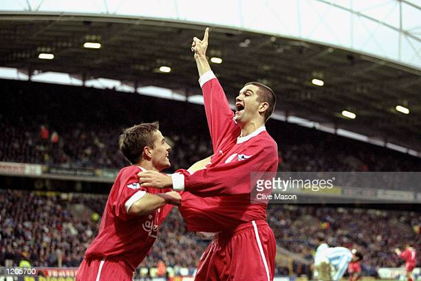 Dominic Matteo of Liverpool celebrates with Michael Owen during the FA Cup Round 3 match against Huddersfield played at the McAlpine Stadium in...