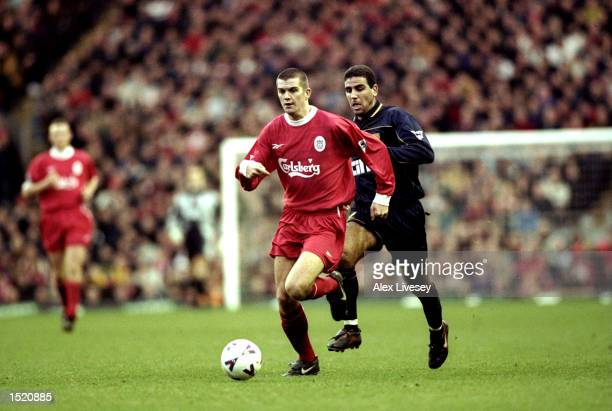 Dominic Matteo of Liverpool is chased by Walid Badir of Wimbledon during the FA Carling Premier League match played at Anfield in Liverpool England...