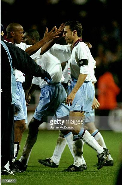 Gareth Southgate of Aston Villa is consoled by his team mates after missing a penalty during the Worthington Cup 5th Round match against West Ham...