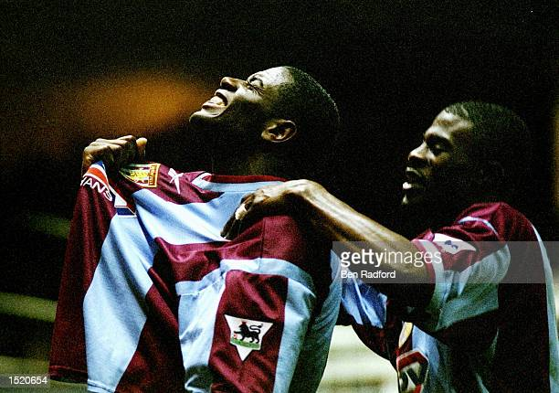 Ian Taylor of Aston Villa celebrates with team mate George Boateng after scoring against Tottenham Hotspur during the FA Carling Premiership match at...
